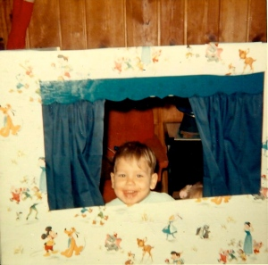 My silly little brother playing in the puppet theater we got for Christmas 1965