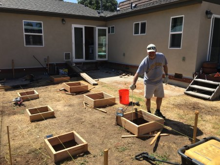 Reg helps Brooks construct the back deck